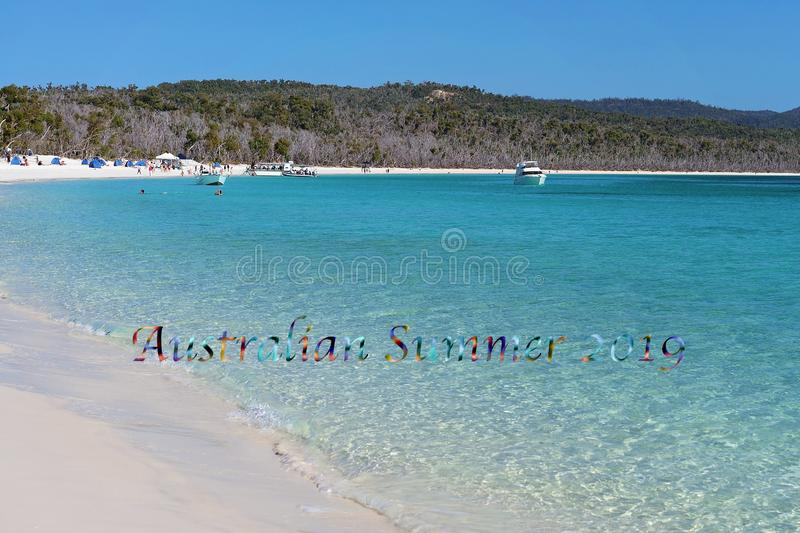 Australian Summer 2019 Text - Leisure Boats And Tourists At A White Silica Sand Beach In Whits. Leisure boats and tourists enjoying the blue water of Whitehaven stock photo