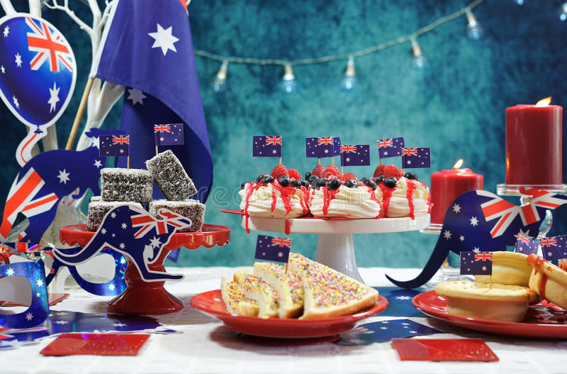 Australian theme party table with flags and iconic food stock images