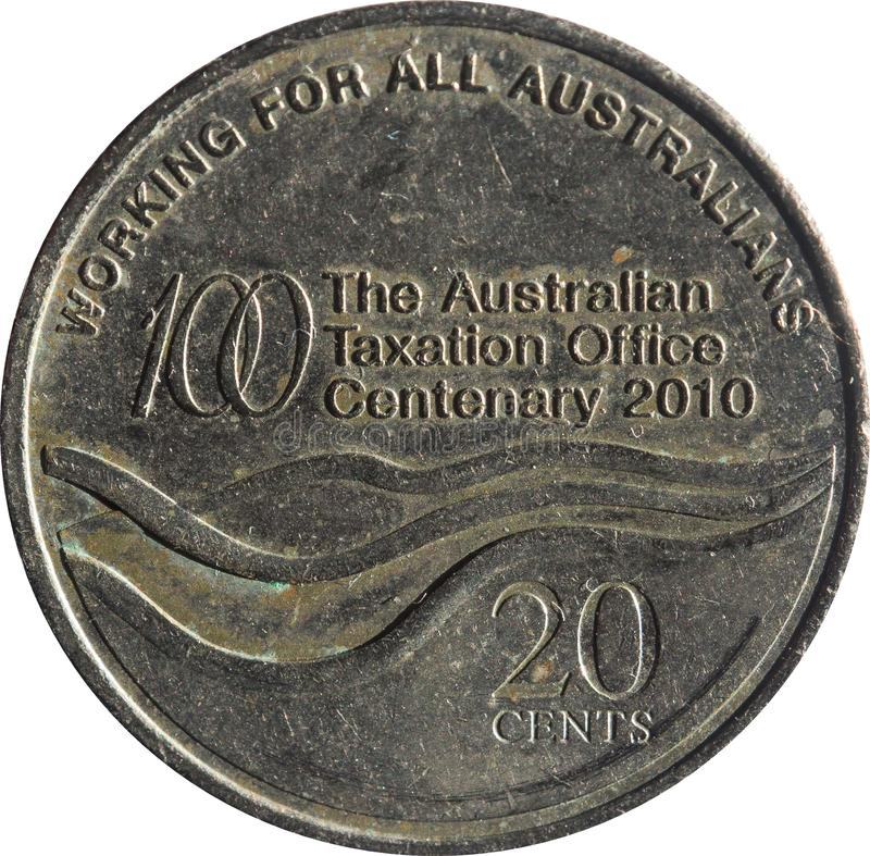 The Australian twenty-cent coin features Commemorating the Centenary of Australian Taxation Office, Isolated on white background. Australian twenty-cent coin royalty free stock images