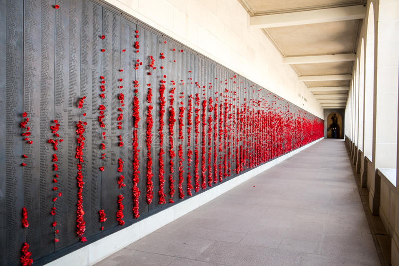 Australian War Memorial Wall of Honour. Red poppies on the Australian War Memorial Wall of Honour stock photography