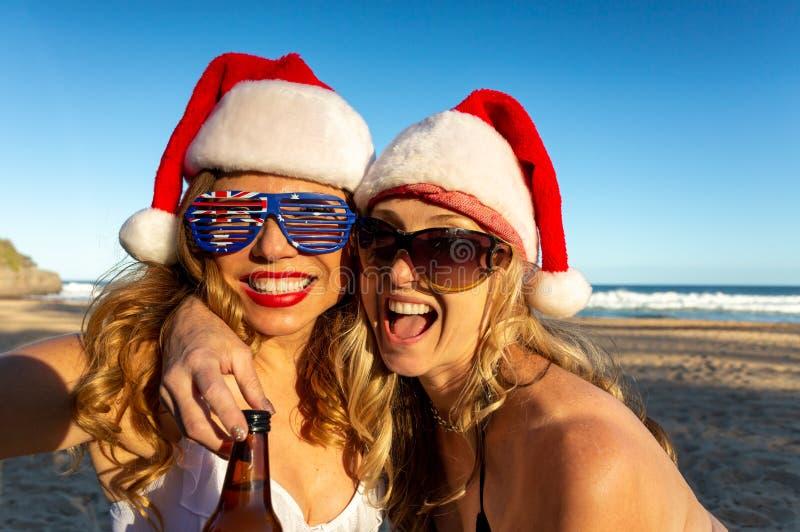 Australians reveling on beach at Christmas time stock photo
