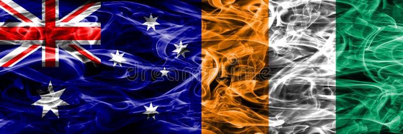 Australien gegen die bunte Rauchflagge der Elfenbeinküste gemacht vom dicken Rauche lizenzfreie abbildung