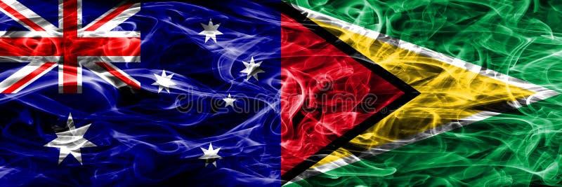 Australien gegen die bunte Rauchflagge Guyanas gemacht vom dicken Rauche stock abbildung