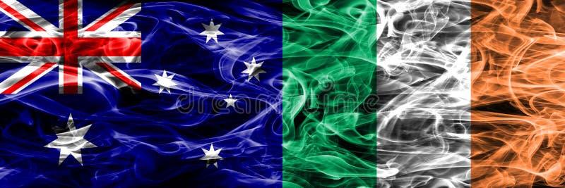 Australien gegen die bunte Rauchflagge Irlands gemacht vom dicken Rauche lizenzfreie abbildung