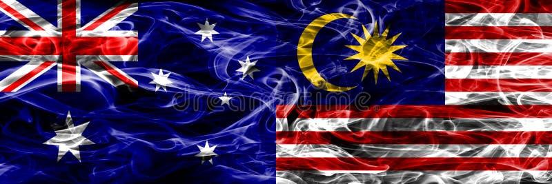 Australien gegen die bunte Rauchflagge Malaysias gemacht vom dicken Rauche lizenzfreie abbildung