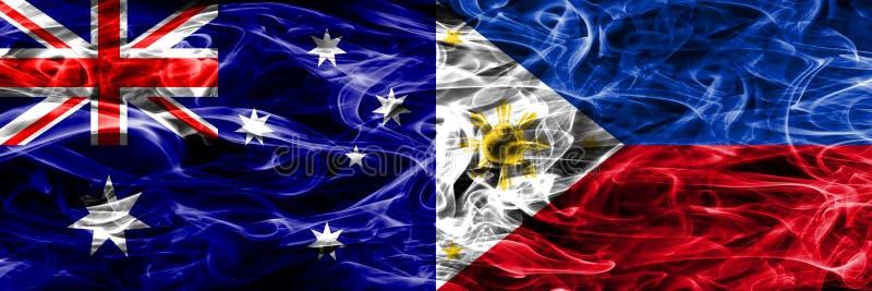 Australien gegen die bunte Rauchflagge Philippinen gemacht vom dicken Rauche stock abbildung