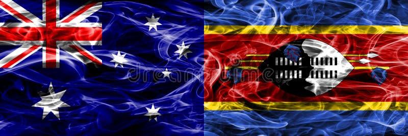 Australien gegen die bunte Rauchflagge Swasilands gemacht vom dicken Rauche lizenzfreie abbildung