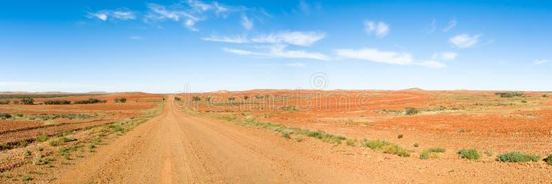 Australien long outback väg straight fotografering för bildbyråer