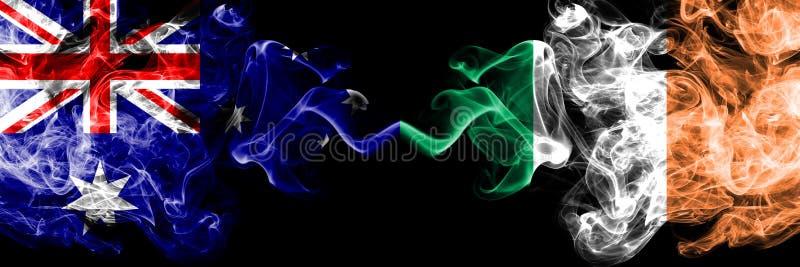Australien vs Irland, irländska rökiga mystikerflaggor förlade sidan - vid - sidan Tjockt kulört silkeslent röker kombination av  royaltyfri bild