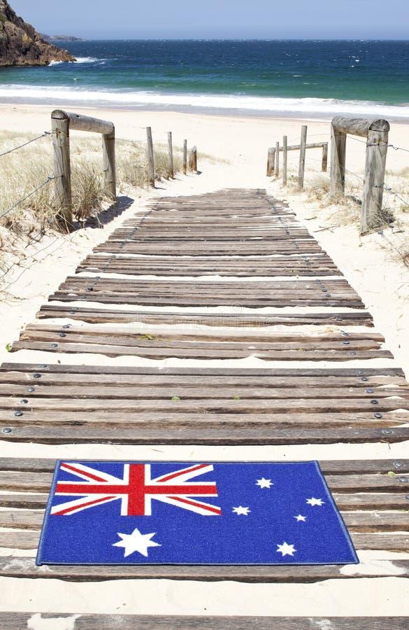Australier välkomna Mat Beach royaltyfri foto