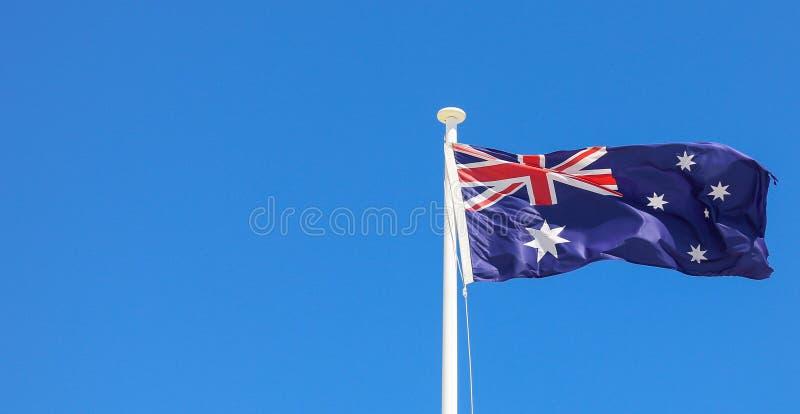 Australijczyka chorągwiany latanie na flagpole zdjęcie stock