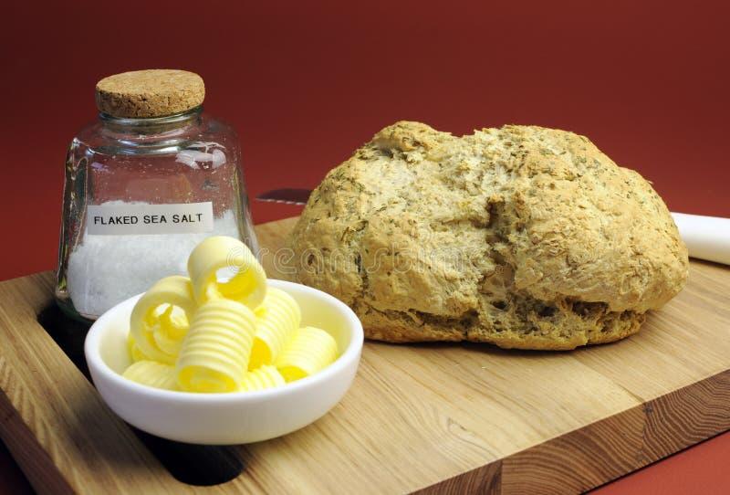 Australijski tradycyjny zwilżacza chleb z masło kędziorami zdjęcia stock