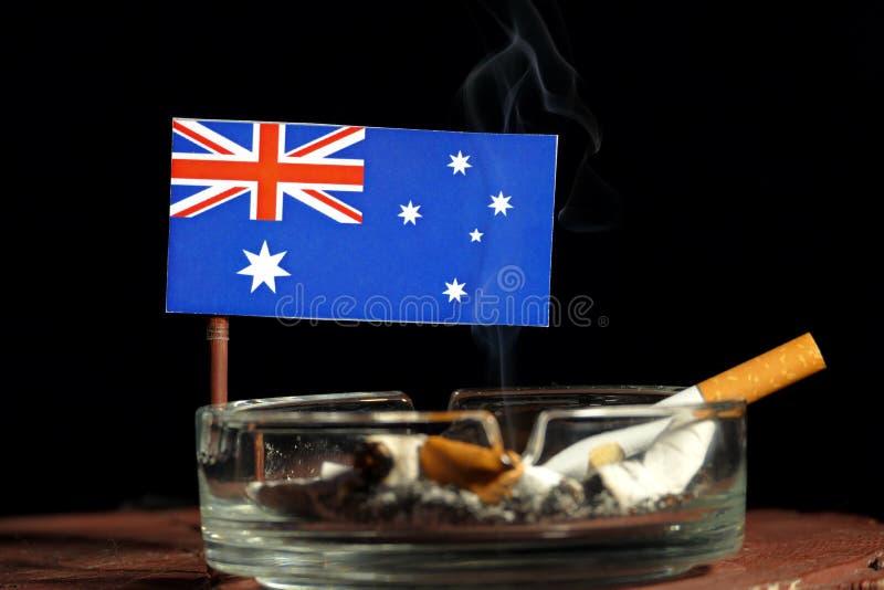 Download Australische Flagge Mit Brennender Zigarette Im Aschenbecher Lokalisiert Auf Schwarzem Stockfoto - Bild von lebensstil, australisch: 96932264