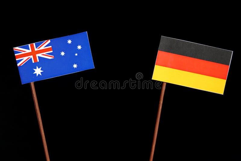 Download Australische Flagge Mit Der Deutschen Flagge Lokalisiert Auf Schwarzem Stockbild - Bild von getrennt, markt: 96932329