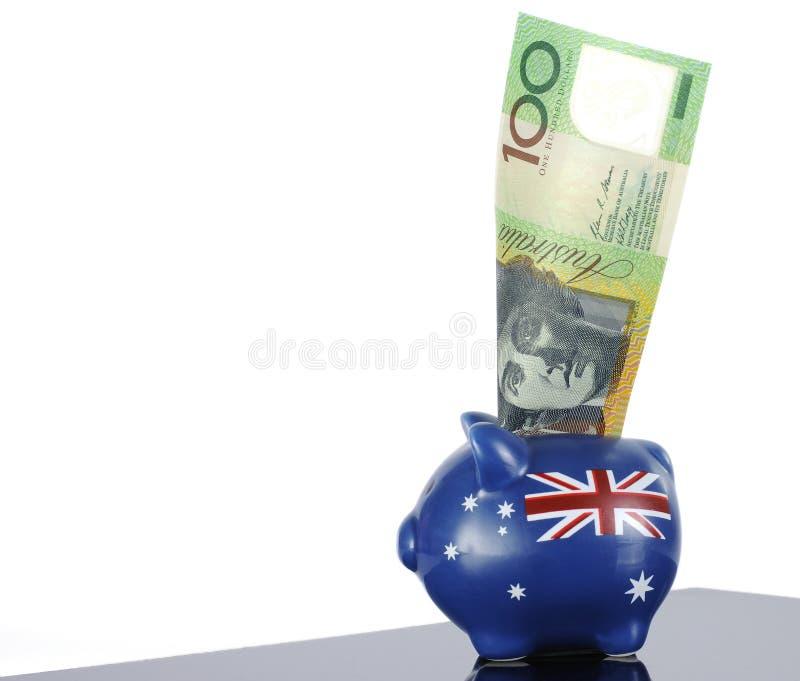 Australische honderd dollarnota in spaarvarken stock foto's