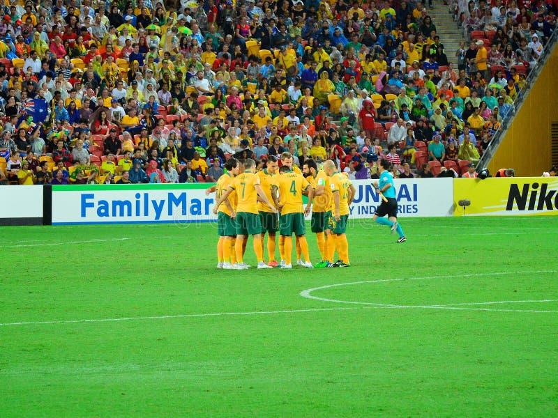 Australischer nationaler Fußball Team Huddle lizenzfreies stockbild