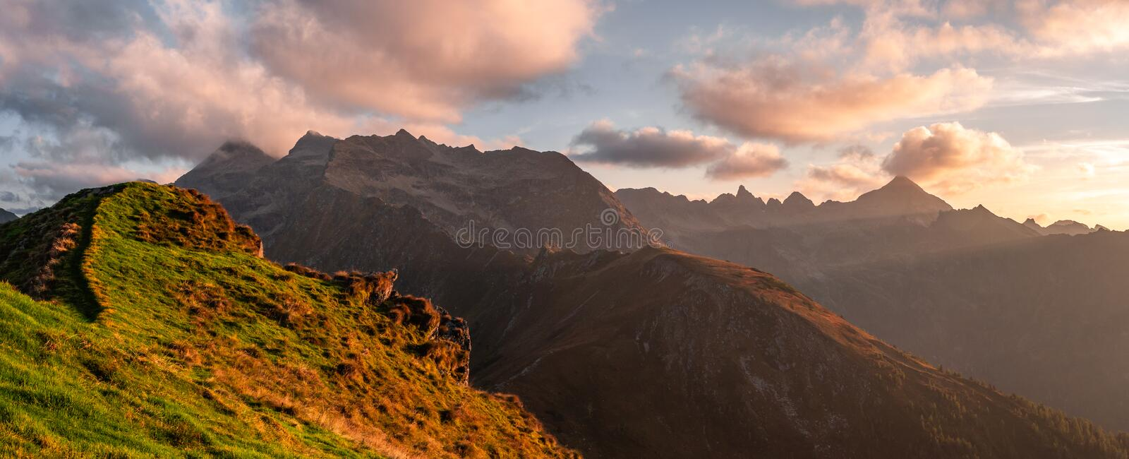 Austria Alps sunset - panorama. From top of mountain stock images