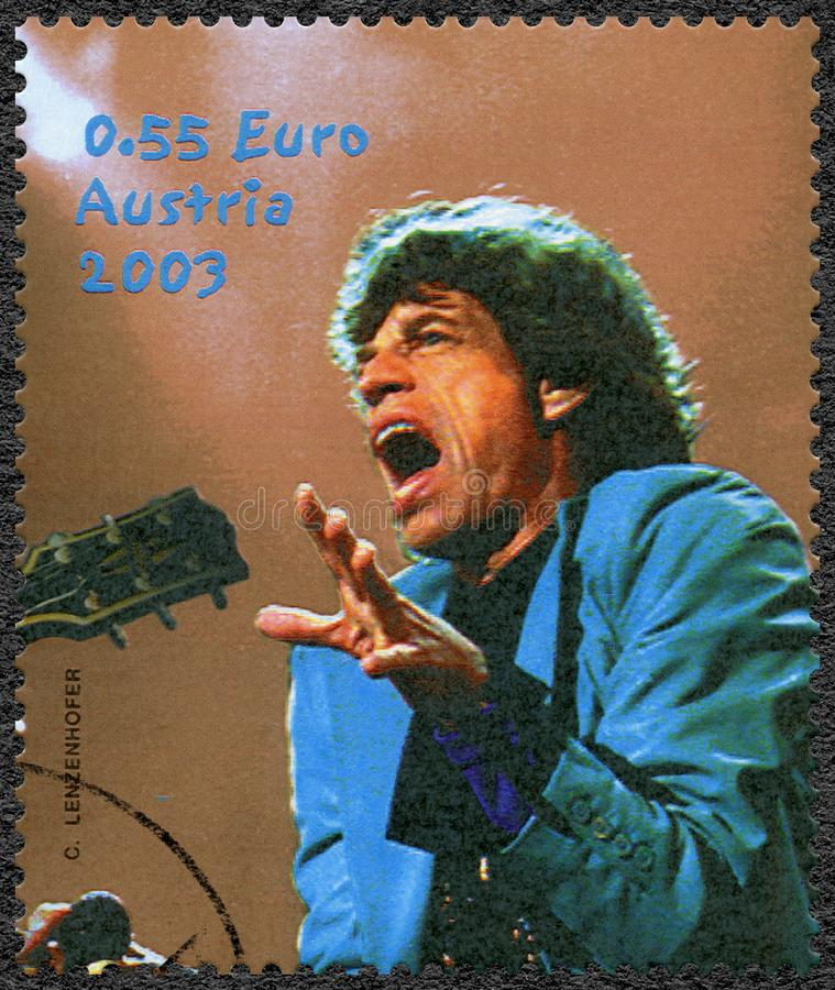 AUSTRIA - 2003: shows Sir Michael Philip Jagger born 1943, English singer, songwriter, The Rolling Stones. AUSTRIA - CIRCA 2003: A stamp printed in Austria shows stock image