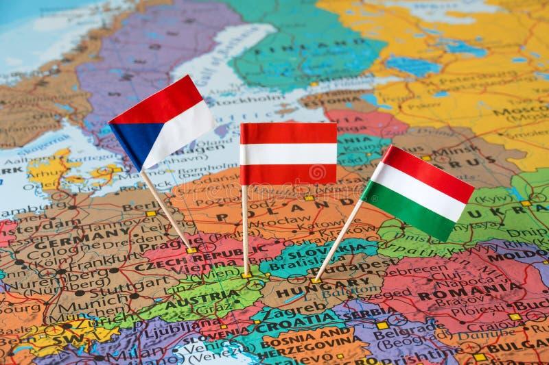 Austria, Czech Republic, Hungary flag pins, Central Europe map. Flags of Austria, Czech Republic and Hungary, Central Europe map, travel concept royalty free stock photo
