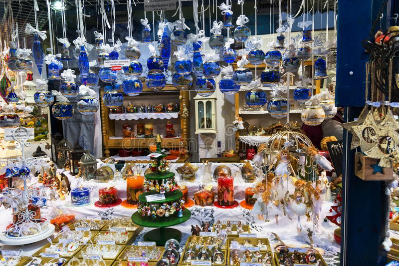 Austria-Linz - December 6, 2018: Hand crafted artisan blue white crystal golden silver painted glass balls at Christmas market. Austria-Linz - December 6, 2018 stock image