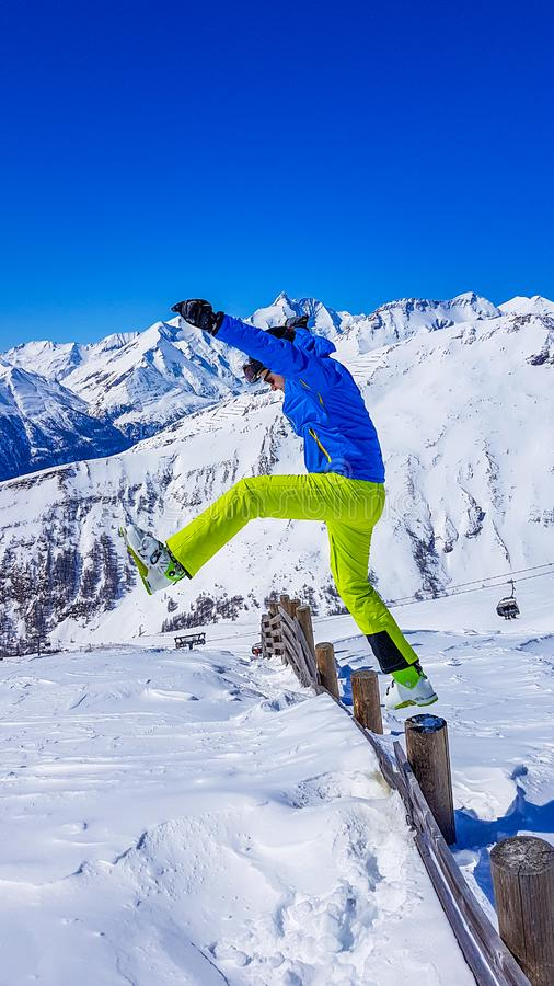 Austria - Man in a skiing outfit jumping into the fresh snow stock photography