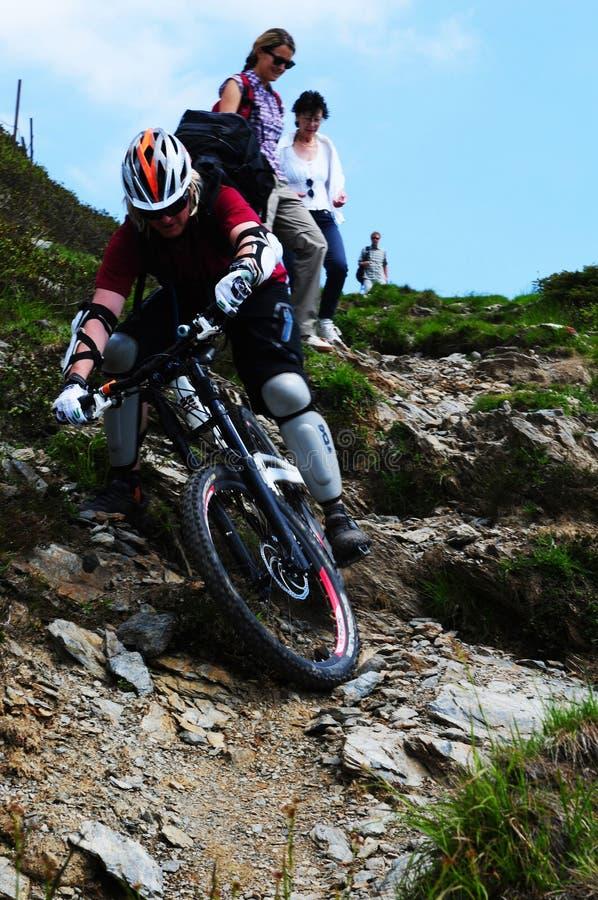 Mountain biker driving downhill Spieljoch stock photos
