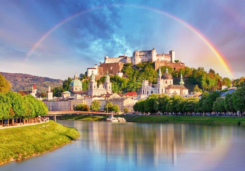 Austria, Rainbow over Salzburg castle royalty free stock photography