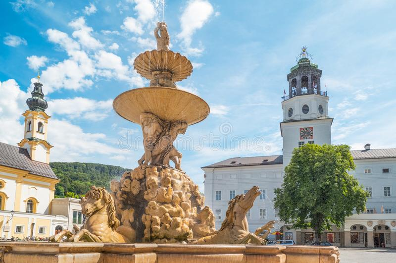 The historic places of Salzburg. Austria, Salzburg, the fountain of Residence square in the old town stock image