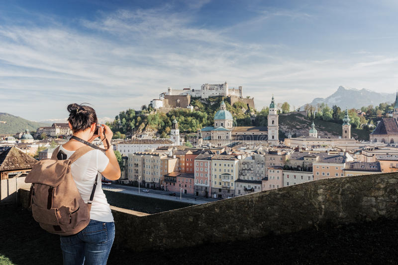 Austria. Salzburg. A young tourist girl takes pictures. Of the historic center of Salzburg: UNESCO World Cultural Heritage stock photos