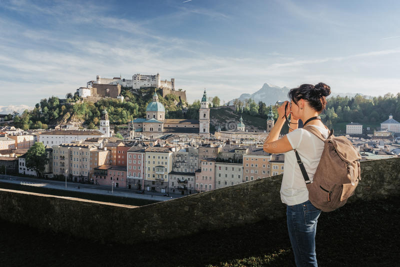 Austria. Salzburg. A young tourist girl takes pictures royalty free stock photos