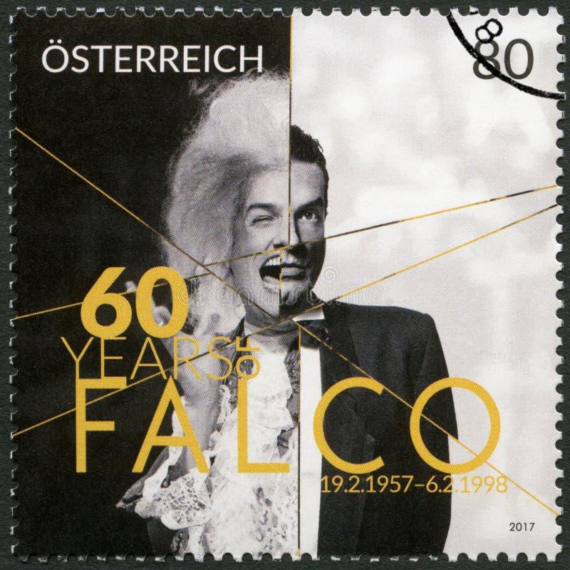 AUSTRIA - 2017: shows Johann Holzel Falco 1957-1998, singer, songwriter and rapper. AUSTRIA - CIRCA 2017: A stamp printed in Austria shows Johann Holzel Falco stock photography