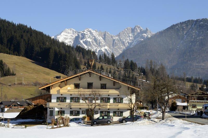 Austria, Tirol, farm house in mountain village. Austria, farm house in Tyrol and Loferer Steinberge Mountain in background stock photo