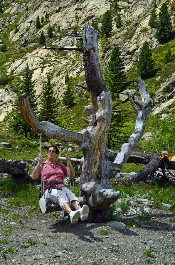 Austria, Tirol, woman on swing stock image