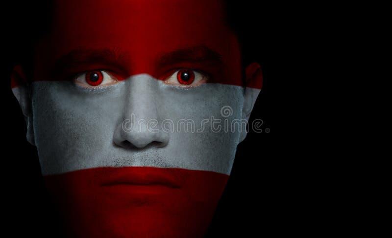 austriacka twarzy dolców flagę fotografia royalty free