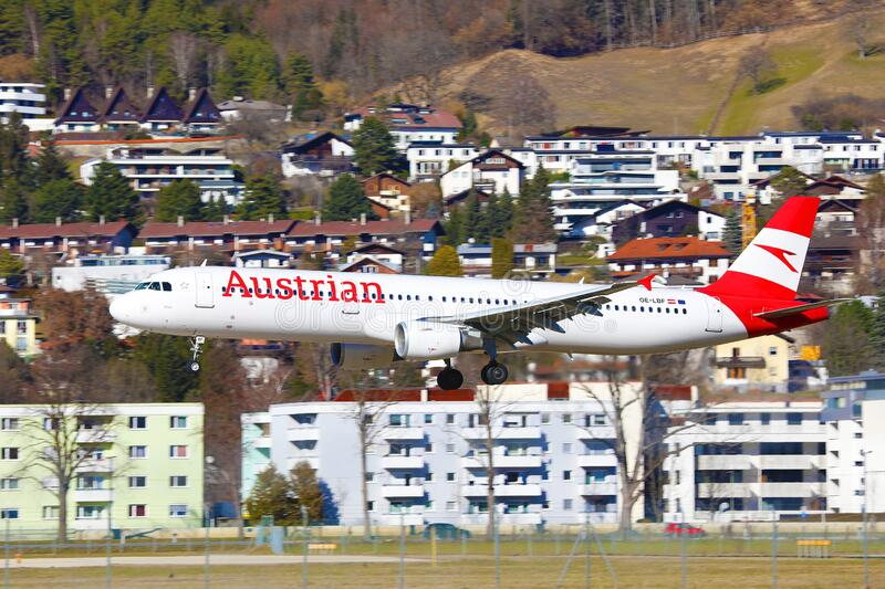 Austrian Airlines airplane landing at Innsbruck Airport, INN royalty free stock images