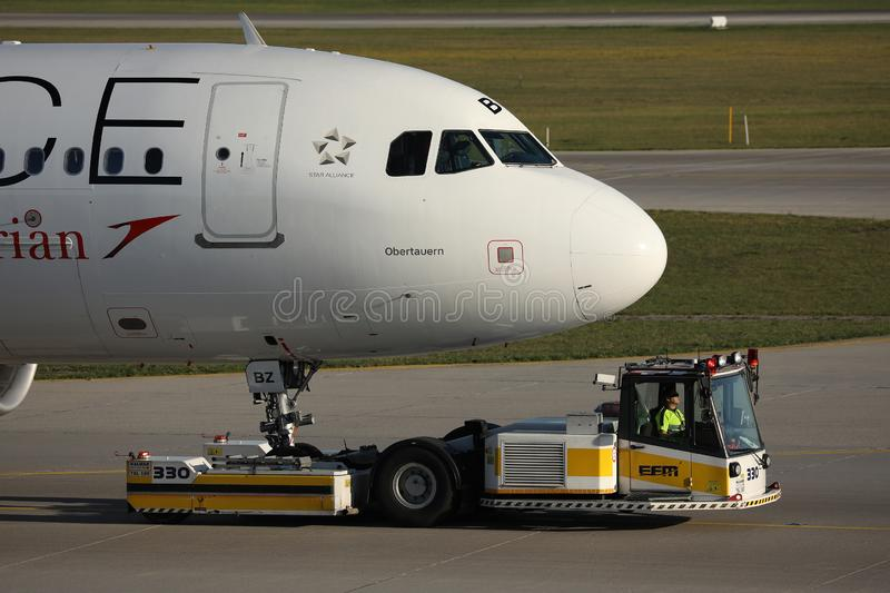 Austrian Airlines Star Alliance plane being towed. Austrian Airlines plane taxiing on taxiway. Star Alliance livery royalty free stock photography
