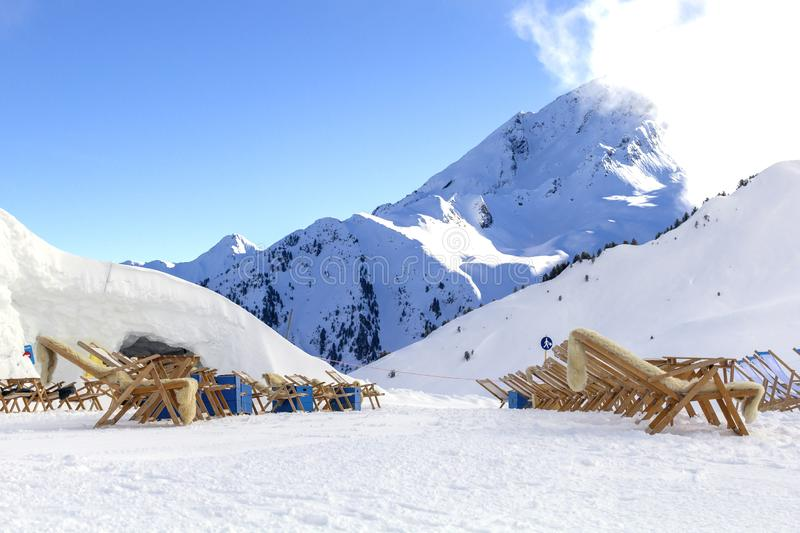 Austrian Alps ski resort in winter.Alpine Alps mountain landscape at Tirol, Top of Europe. Austrian Alps in winter.Ski resort with sunbeds.Alpine Alps mountain royalty free stock images