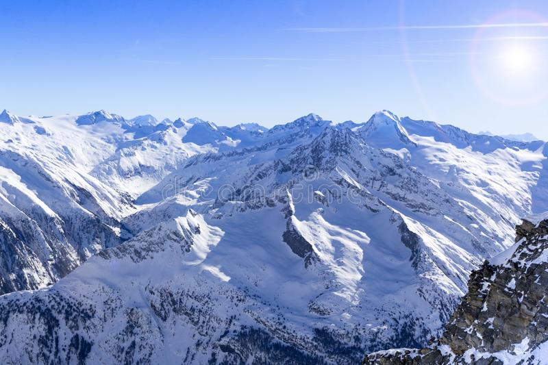 Austrian Alps in winter.Alpine Alps mountain landscape at Tirol, Top of Europe. Sunny day and blue sky stock image