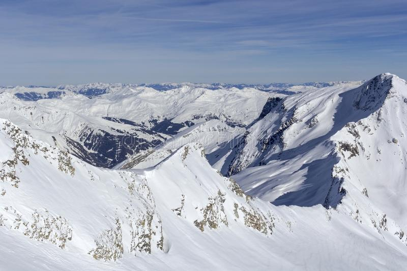 Austrian Alps in winter.Alpine Alps mountain landscape at Tirol, Top of Europe. Sunny day and blue sky stock images