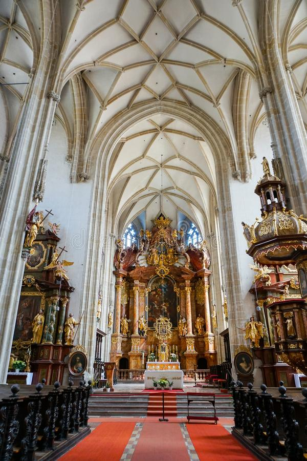 Austrian Christian Cathedral inside with wonderful ceiling. Concept of Catholic interior and religious decorations royalty free stock images