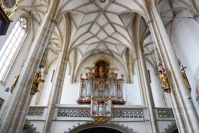 Austrian Christian Cathedral inside with wonderful decorated ceiling. Concept of Catholic interior and religious decorations royalty free stock images