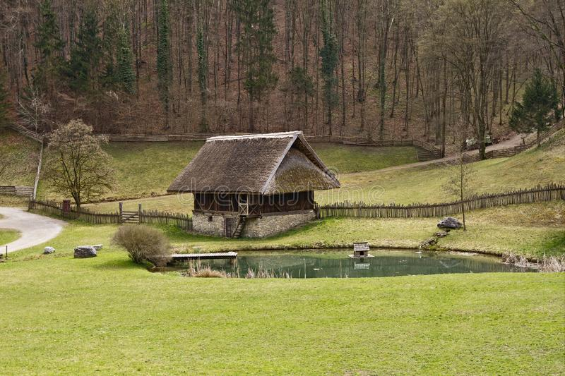 The Austrian Open-Air museum Stuebing near Graz: Barn and byre f. Open-Air Museum Stuebing: Barn and byre with straw-thatched roof from Voran South Tyrol stock photos