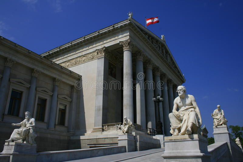 Austrian Parliament Building. A row of statues of great philosophers and thinkers leading towards the building of the Austrian Parliament stock photos