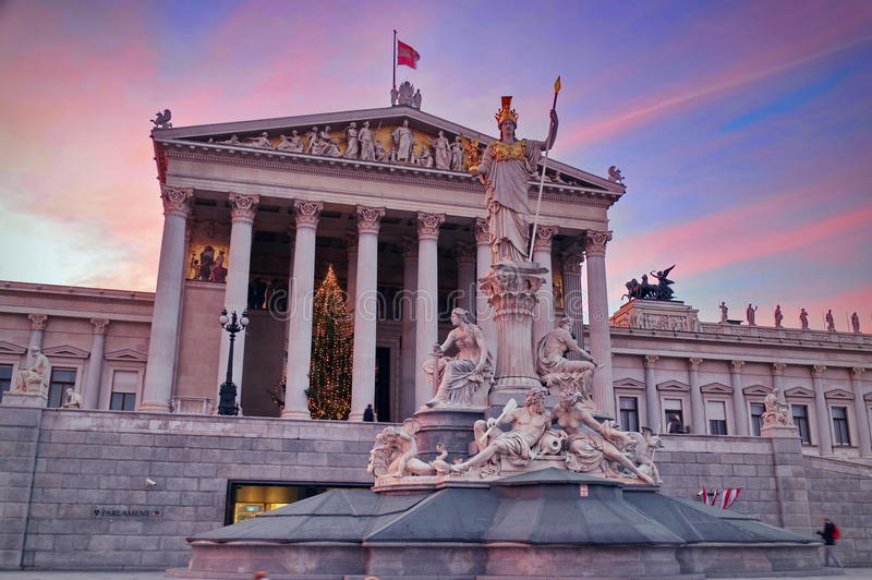 Austrian Parliament Building and Statue of Athena in the spectacular sunset light - landmark attraction in Vienna, Austria. Spectacular sunset with the statue of royalty free stock photography