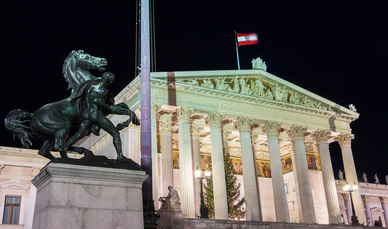 The Austrian Parliament at night, Vienna. The Austrian Parliament palace in Vienna at night.The foundation stone was laid in 1874 , the building was completed stock photography