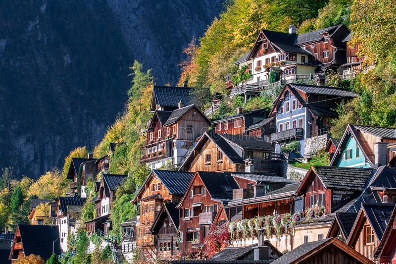 Old alpine houses of austrian town Hallstatt with wooden and colorful facades. Austrian town Hallstatt is squeezed tightly between the lake and the mountain of royalty free stock photography