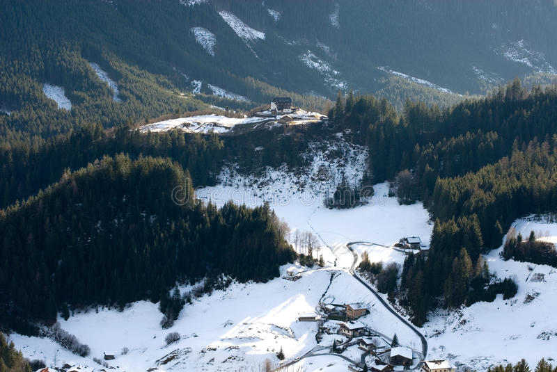 An Austrian Winter Scene. Snow-covered chalets in a forest, Austria stock photo