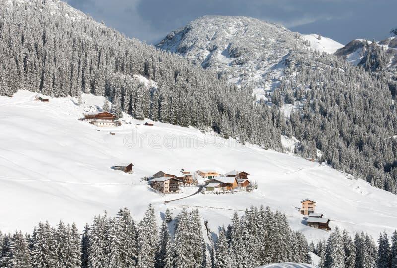 Austrian Winter Scene. Chalets and farmhouses, near Mount Biberkopf, Warth am Alberg, Vorarlberg, Austria stock photography