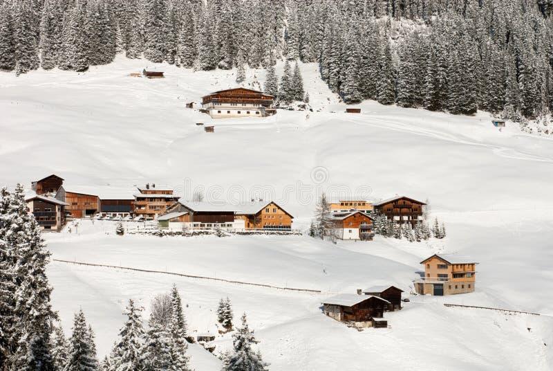 Austrian Winter Scene. Chalets and farmhouses, near Mount Biberkopf, Warth am Alberg, Vorarlberg, Austria stock photos