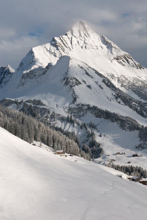 Austrian Winter Scene. Chalets near the village of Warth-Schrocken, and Mount Biberkopf, Warth am Alberg,Vorarlberg, Austria stock photography